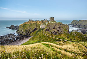 Distant view of Dunnotar Castle near Stonehaven sitting on the clifftops.