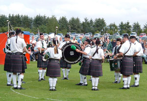 A pipe band playing music at Aden Country Park.
